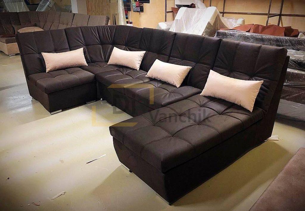 Черный угловой диван прошитый